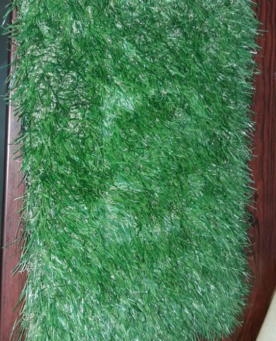 Artificial grass carpet in rectangular and unfolded shape - The grass carpet made with plastic material available for sale online in Hyderabad